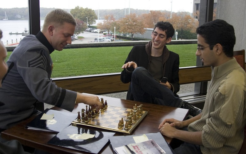 West Point student and Tufts student playing chess