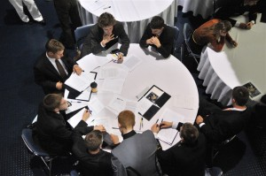 students focus at conference table